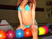 Asian babe in bikini plays bowling