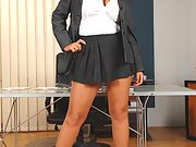 Watch sexy busty secretary Ines Cudna stripping nude for you