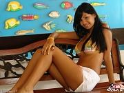 Cute Latin teen in her tiny bikini