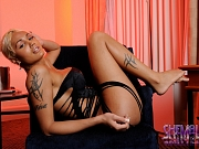 Shemale Olivia Starr strokes cock