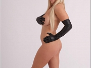 Blonde with leather gloves posing