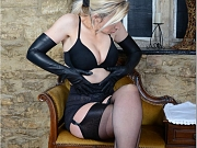 Hot Milf teases in leather lingerie