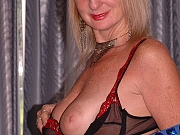 Sexy British Grandma gets nude and masturbates