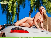 Nothing better than a hot busty blonde totally naked climbing on top of a sports car