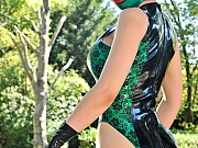 Latex Lucy in rubber mask and bodysuit posing big tits outdoors