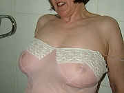 Big breasted hairy mature bathes in see through slip