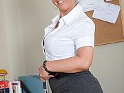 Bigtits milf secretary in black stockings strips