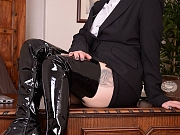 Busty Mistress waits for you on desk is sexy leather thigh boots