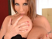 Laura Orsolya with huge melons toying a bed