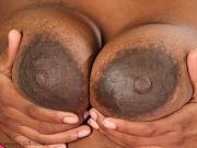 Lactating ebony Honey expresses and sprays her milk