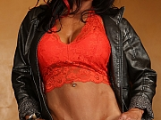 Sizzling Brunette Female Bodybuilder Stripping