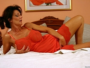 Hot milf Deauxma plays with anal beads in her  ass