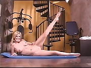 Sexy blond with nice tits exerciseing and using dildo to fuck her tight cunt