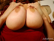 Julia Ann sits by the piano and gives you a close up of her clit