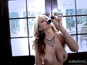 Julia Ann sits on the floor and masturbates with her toy