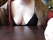 Woman with deep cleavage in restaurant