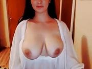 Pink nips on big natural pair under white lingerie