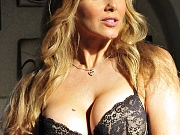 Julia Ann wears a black sexy bra and panties and strips