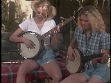 Banjo-playing blonde tramps with nice tits are fucked by lucky redneck on farm