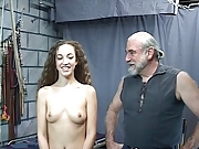 Hard spanking for this restrained bdsm victim brunette girl in dungeon
