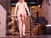 Hot young blonde works out naked and plays with a pussy