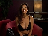 Smoking hot brunette flashes her big tits