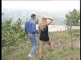Busty blond gives a wild and wet bj outside