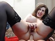 Nasty girl with huge tits and braces fucks dildo
