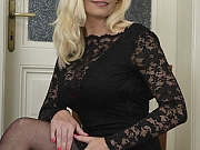 Lilly Peterson busty blonde in black dress and stockings strips