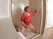 60 Plus GILF gets off in wet t-shirt