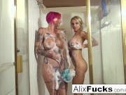 Two busty hotties take a sexy shower