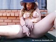 Redhead busty babe toys her creamy pussy outdoors
