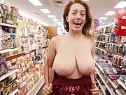 Redhead Flashes Huge Tits in Store